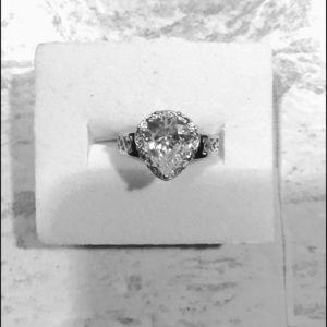 Cubic zirconia diamond and silver ring.